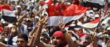 LaPresse20-04-2012 CairocronacaEgitto, raduno in piazza Tahrir per proteggere la rivoluzione‎Egyptian protesters chant slogans and wave national flags during a rally in Tahrir Square in Cairo, Egypt, Friday, April 20, 2012. Tens of thousands of protesters packed Cairo's downtown Tahrir Square on Friday in the biggest demonstration in months against the ruling military, aimed at stepping up pressure on the generals to hand over power to civilians and bar ex-regime members from running in upcoming presidential elections.